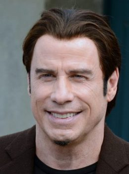 John Travolta his beliefs religion family